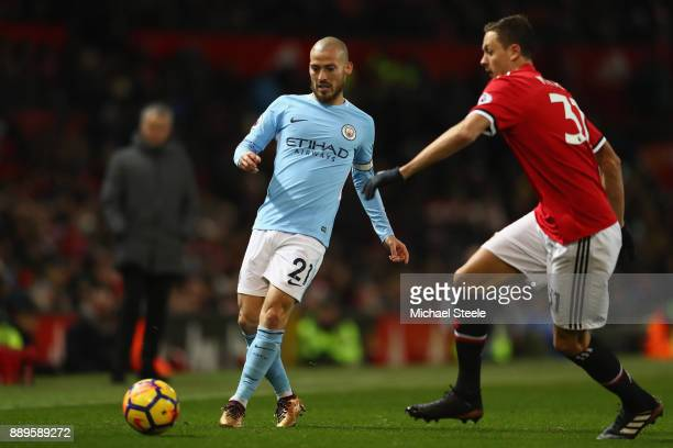 David Silva of Manchester City passes as Nemanja Matic of Manchester United closes in during the Premier League match between Manchester United and...