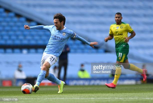 David Silva of Manchester City passes the ball during the Premier League match between Manchester City and Norwich City at Etihad Stadium on July 26...