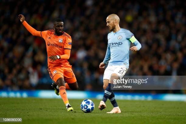 David Silva of Manchester City passes the ball under pressure from Tanguy NDombele Alvaro of Lyon during the Group F match of the UEFA Champions...
