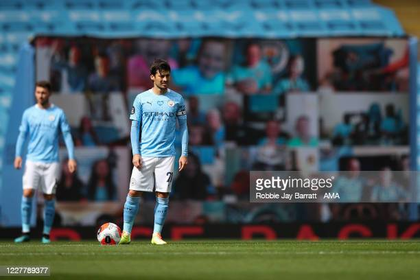 David Silva of Manchester City prepares to kick off for his final league match for the club during the Premier League match between Manchester City...