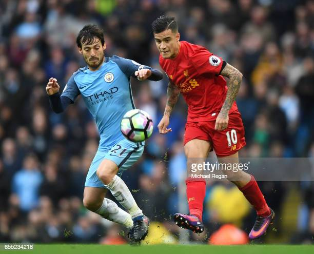 David Silva of Manchester City puts pressure on Philippe Coutinho of Liverpool during the Premier League match between Manchester City and Liverpool...