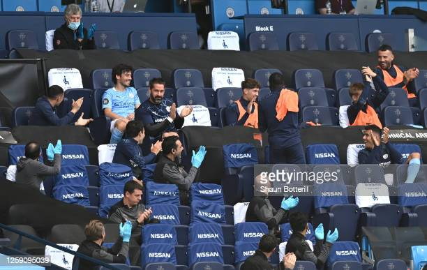 David Silva of Manchester City receives a standing ovation from the Manchester City bench after being substituted in his final appearance for...