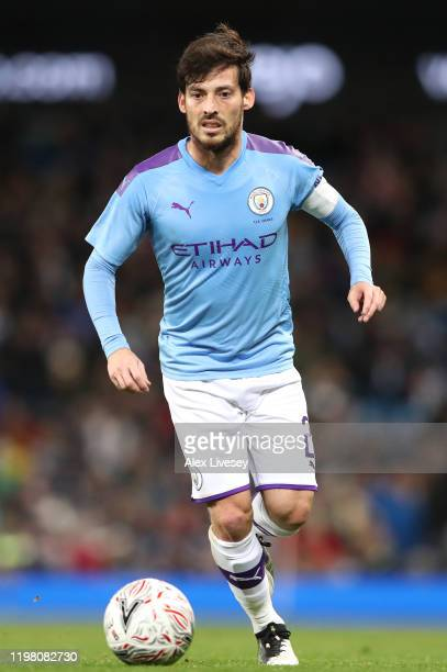 David Silva of Manchester City runs with the ball during the FA Cup Third Round match between Manchester City and Port Vale at Etihad Stadium on...