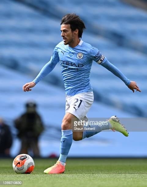 David Silva of Manchester City runs with the ball during the Premier League match between Manchester City and Norwich City at Etihad Stadium on July...