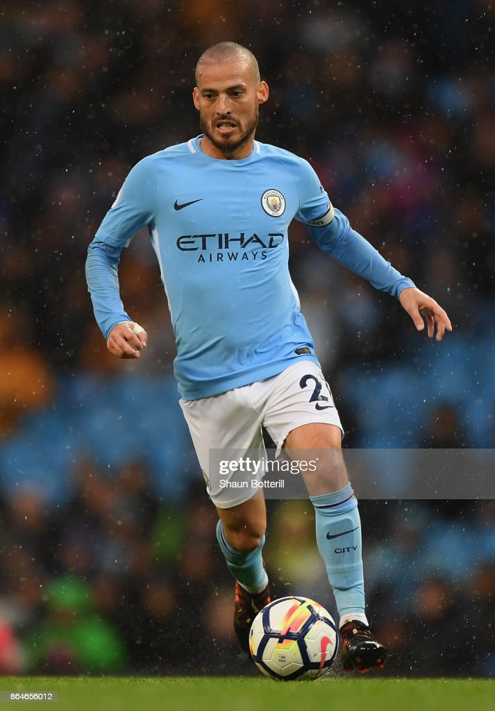 David Silva of Manchester City runs with the ball during the Premier League match between Manchester City and Burnley at Etihad Stadium on October 21, 2017 in Manchester, England.