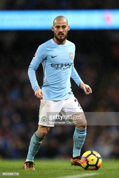 David Silva of Manchester City runs with the ball during the Premier League match between Manchester City and Watford at Etihad Stadium on January 2...