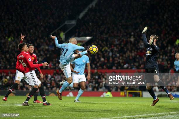 David Silva of Manchester City scores a goal to make it 01 during the Premier League match between Manchester United and Manchester City at Old...