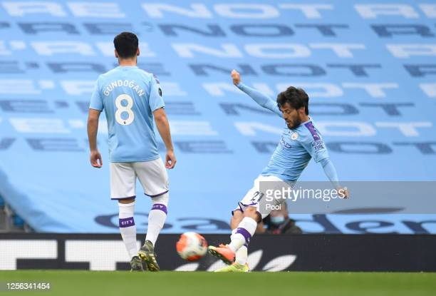 David Silva of Manchester City scores his sides first goal during the Premier League match between Manchester City and AFC Bournemouth at Etihad...