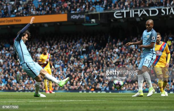 David Silva of Manchester City scores his sides first goal during the Premier League match between Manchester City and Crystal Palace at the Etihad...