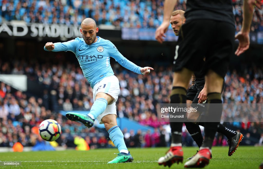 David Silva of Manchester City scores his side's first goal during the Premier League match between Manchester City and Swansea City at Etihad Stadium on April 22, 2018 in Manchester, England.