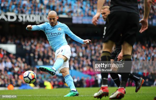 David Silva of Manchester City scores his side's first goal during the Premier League match between Manchester City and Swansea City at Etihad...