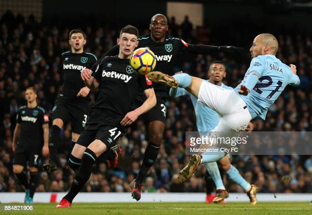 David Silva of Manchester City scores his sides second goal during the Premier League match between Manchester City and West Ham United at Etihad...