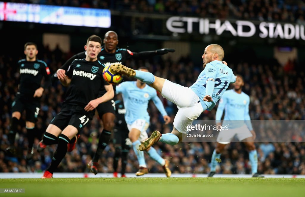David Silva of Manchester City scores his sides second goal during the Premier League match between Manchester City and West Ham United at Etihad Stadium on December 3, 2017 in Manchester, England.