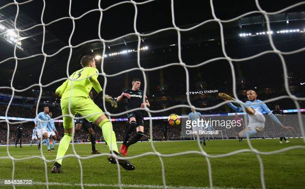 David Silva of Manchester City scores his sides second goal past Adrian of West Ham United during the Premier League match between Manchester City...