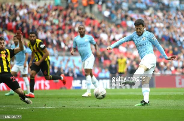 David Silva of Manchester City scores his team's first goal during the FA Cup Final match between Manchester City and Watford at Wembley Stadium on...