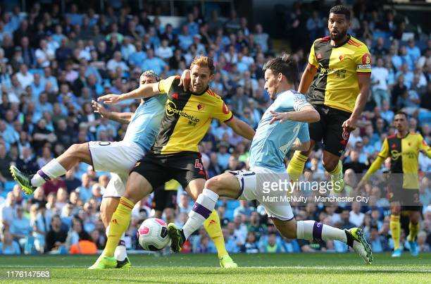 David Silva of Manchester City scores his team's first goal during the Premier League match between Manchester City and Watford FC at Etihad Stadium...