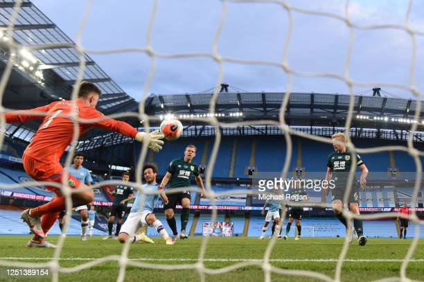 David Silva of Manchester City scores his team's fourth goal during the Premier League match between Manchester City and Burnley FC at Etihad Stadium...