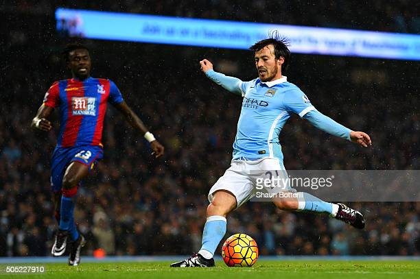 David Silva of Manchester City scores his team's fourth goal during the Barclays Premier League match between Manchester City and Crystal Palace at...