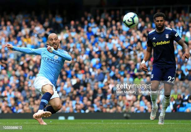 David Silva of Manchester City scores his team's second goal during the Premier League match between Manchester City and Fulham FC at Etihad Stadium...