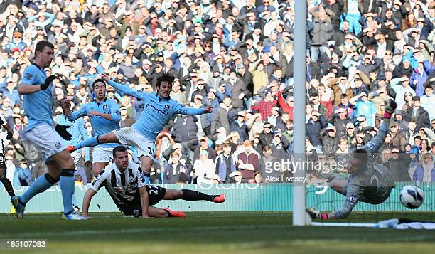 David Silva of Manchester City scores his team's second goal during the Barclays Premier League match between Manchester City and Newcastle United at...