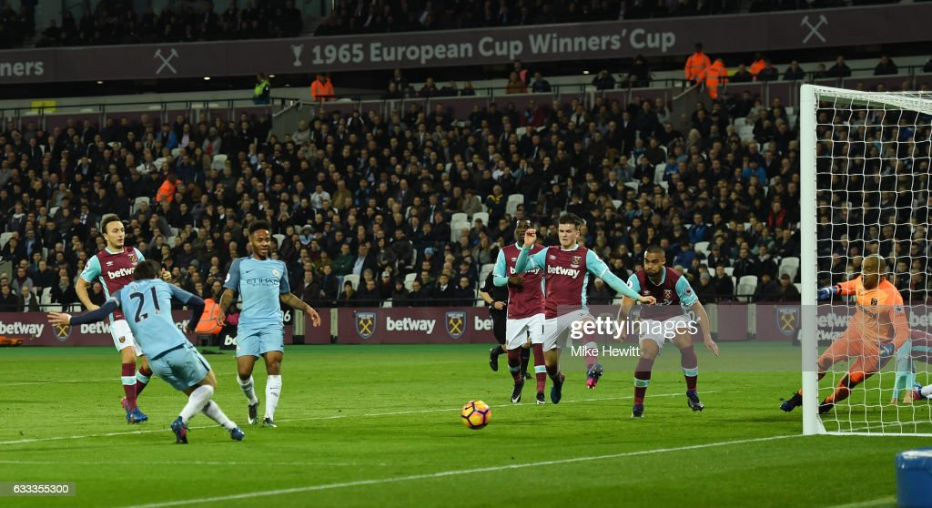 David Silva of Manchester City scores his team's second goal during the Premier League match between West Ham United and Manchester City at London Stadium on February 1, 2017 in Stratford, England.