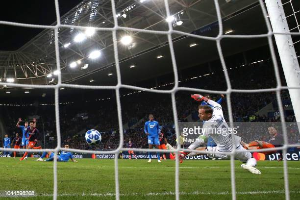 David Silva of Manchester City scores his team's second goal past Oliver Baumann of 1899 Hoffenheim during the Group F match of the UEFA Champions...