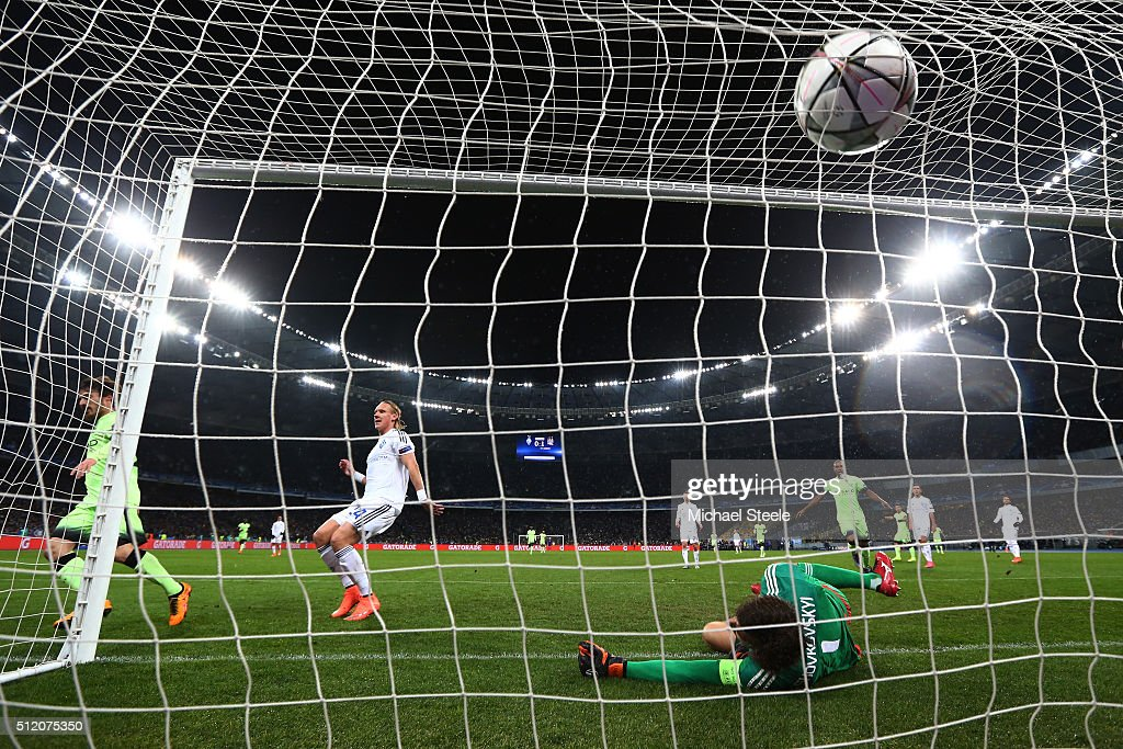 David Silva of Manchester City scores his team's second goal past goalkeeper Oleksandr Shovkovskiy of Dynamo Kiev during the UEFA Champions League round of 16, first leg match between FC Dynamo Kyiv and Manchester City FC at the Olympic Stadium on February 24, 2016 in Kiev, Ukraine.
