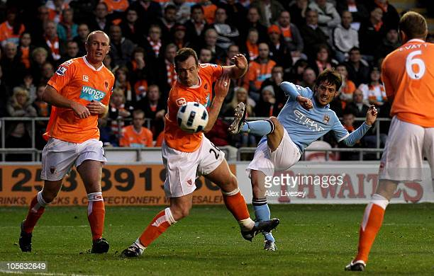 David Silva of Manchester City scores his team's third goal during the Barclays Premiership match between Blackpool and Manchester City at Bloomfield...