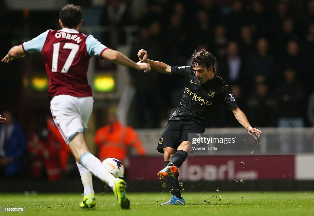 David Silva of Manchester City scores his team's third goal during the Barclays Premier League match between West Ham United and Manchester City at Boleyn Ground on October 19, 2013 in London, England.
