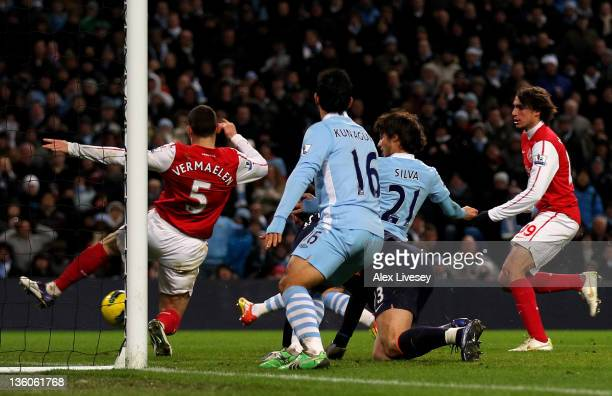 David Silva of Manchester City scores the opening goal during the Barclays Premier League match between Manchester City and Arsenal at the Etihad...