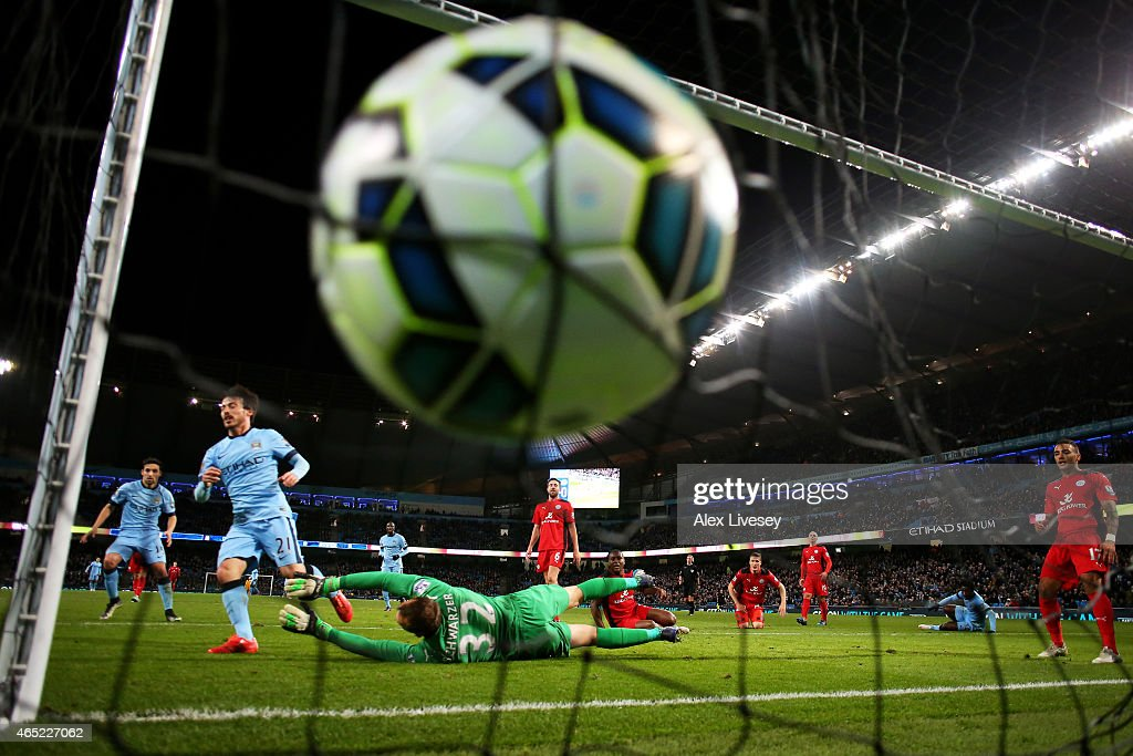 Fotos e imgenes de manchester city v leicester city premier david silva of manchester city scores the opening goal past goalkeeper mark schwarzer of leicester city voltagebd Image collections