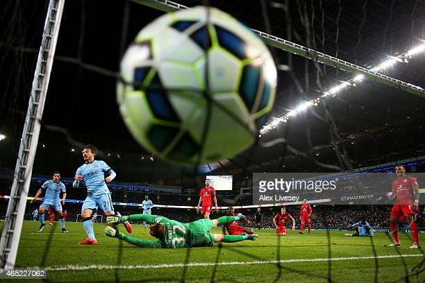 David Silva of Manchester City scores the opening goal past goalkeeper Mark Schwarzer of Leicester City during the Barclays Premier League match...