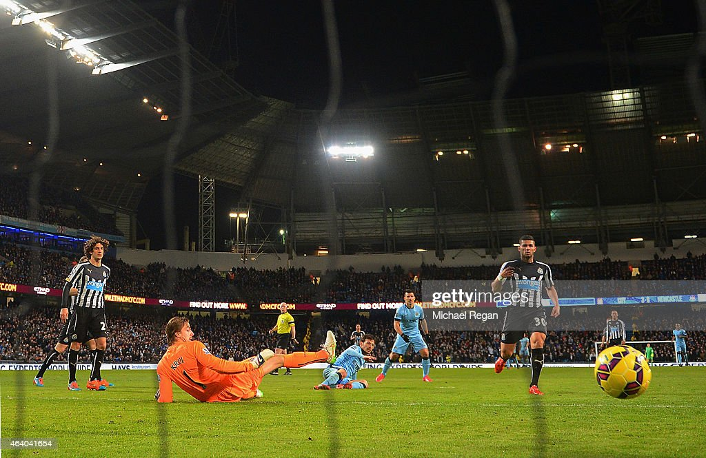 David Silva of Manchester City scores their fourth goal past Tim Krul of Newcastle United during the Barclays Premier League match between Manchester City and Newcastle United at Etihad Stadium on February 21, 2015 in Manchester, England.