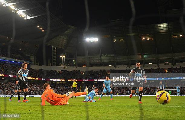 David Silva of Manchester City scores their fourth goal past Tim Krul of Newcastle United during the Barclays Premier League match between Manchester...