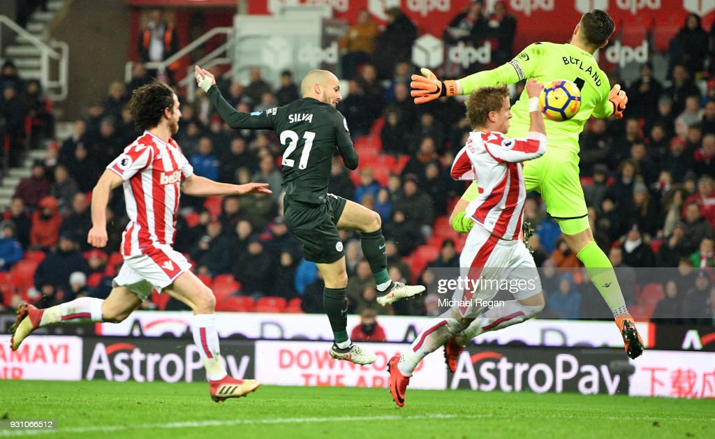 David Silva of Manchester City (21) scores their second goal past Jack Butland of Stoke City (1) during the Premier League match between Stoke City and Manchester City at Bet365 Stadium on March 12, 2018 in Stoke on Trent, England.