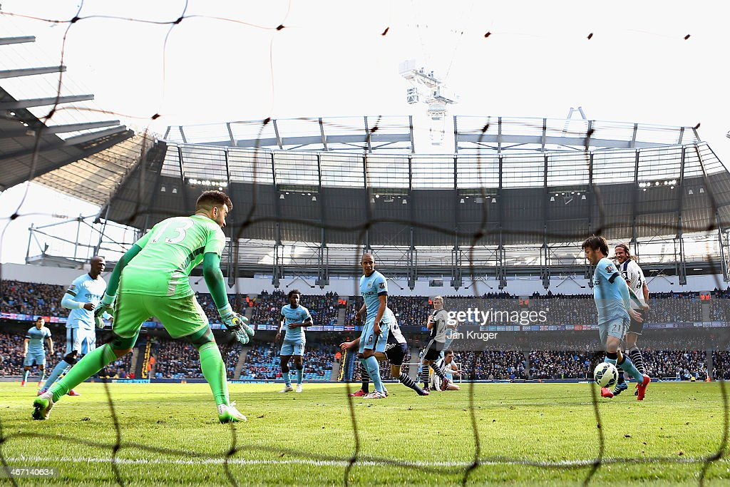 David Silva of Manchester City scores their third goal past Boaz Myhill of West Brom during the Barclays Premier League match between Manchester City and West Bromwich Albion at Etihad Stadium on March 21, 2015 in Manchester, England.