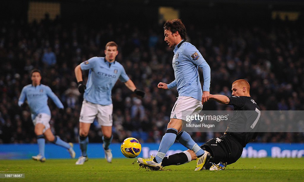 David Silva of Manchester City scores to make it 2-0 during the Barlcays Premier League match between Manchester City and Fulham at the Etihad Stadium on January 19, 2013 in Manchester, England.