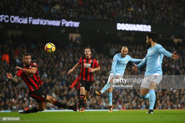 David Silva of Manchester City shoots during the Premier League match between Manchester City and AFC Bournemouth at Etihad Stadium on December 23...