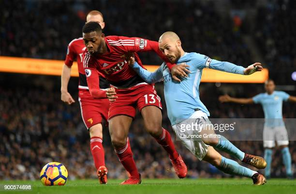 David Silva of Manchester City tackles Molla Wague of Watford during the Premier League match between Manchester City and Watford at Etihad Stadium...