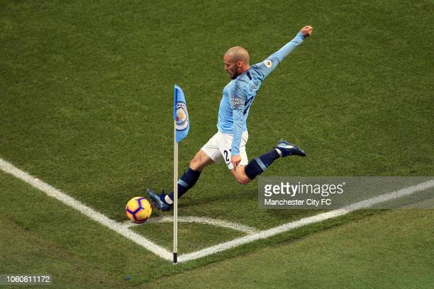 David Silva of Manchester City takes a corner kick during the Premier League match between Manchester City and Manchester United at Etihad Stadium on...