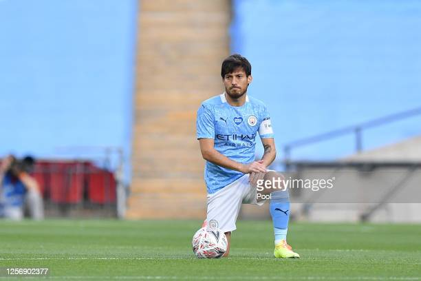 David Silva of Manchester City takes a knee in support of the Black Lives Matter movement prior to the FA Cup Semi Final match between Arsenal and...