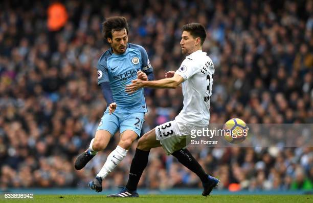 David Silva of Manchester City takes on Federico Fernandez of Swansea City during the Premier League match between Manchester City and Swansea City...