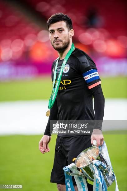 David Silva of Manchester City walks with Carabao Cup trophy during the Carabao Cup Final between Aston Villa and Manchester City at Wembley Stadium...