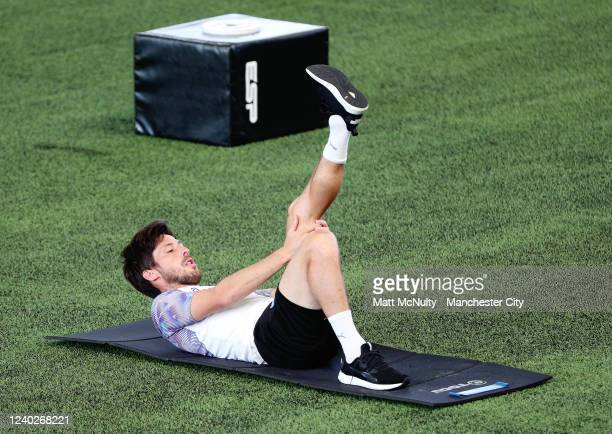David Silva of Manchester City warms up during the training session at Manchester City Football Academy on June 01 2020 in Manchester England