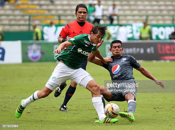 David Silva of Millonarios and Jhon Lozano of Cali fight fir the ball during a match between Deportivo Cali and Millonarios as part of round 13 of...
