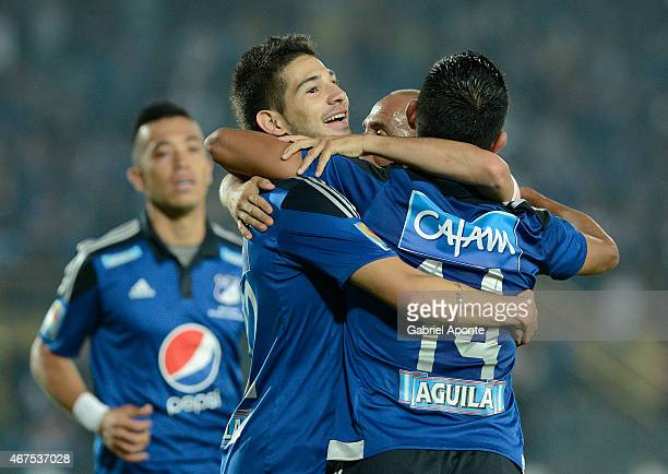 David Silva of Millonarios celebrates with teammates after scoring the tirth goal of his team during a match between Millonarios and Deportivo Pasto...