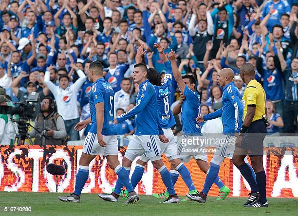 David Silva of Millonarios celebrates with teammates after scoring the opening goal during a match between Millonaris and Santa Fe as part of 10th...