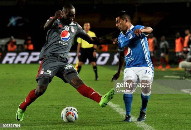 David Silva of Millonarios fights for the ball with Avimiled Rivas of America de Cali during the friendly match between Millonarios and America de...