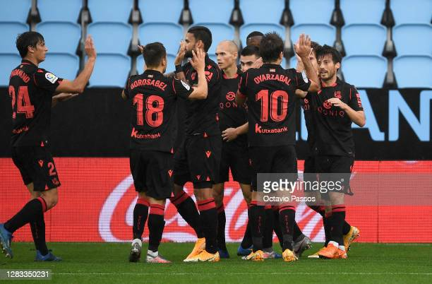 David Silva of Real Sociedad celebrates with teammates after scoring his sides first goal during the La Liga Santander match between RC Celta and...