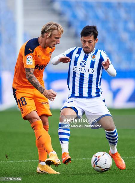 David Silva of Real Sociedad duels for the ball with Daniel Wass of Valencia CF during the La Liga Santander match between Real Sociedad and Valencia...